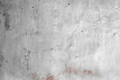 Red aged plaster with damaged paint texture - wonderful abstract photo background. Fantastic red brushed cement with broken paint texture - abstract photo royalty free stock photography