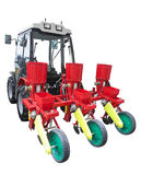Red agricultural seeding machine on tractor isolated over white Stock Photo