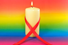 Red Aids Awareness Ribbon Candle with Rainbow Royalty Free Stock Photos