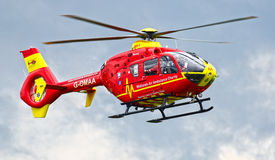 Rescue helicopter. Red rescue air ambulance helicopter flying stock photos