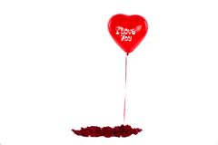 Air ball. Red air ball I love you! White rose petals Stock Image