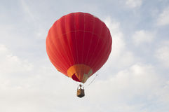 Red air balloon. Against the pale blue sky stock photos