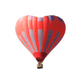 Red air balloon in the shape of a heart isolated on a white background Stock Images