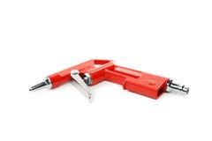 Red air compressor gun. Stock Photos