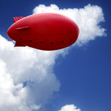Red air ship in blue sky Royalty Free Stock Photo