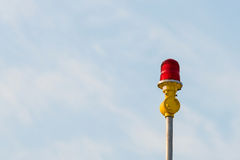 Red aircraft warning lights with blue sky background Royalty Free Stock Image