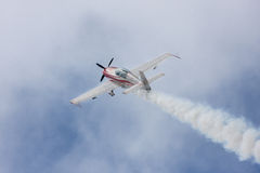 Red airplane. Flying on the sky Royalty Free Stock Photography