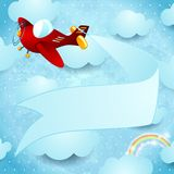 Red airplane with banner Royalty Free Stock Photos