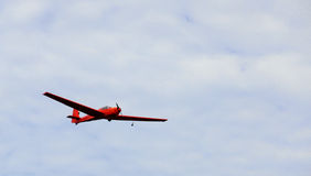 Red airplane in flight Royalty Free Stock Photos