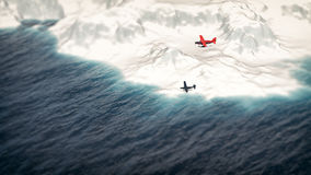 Red airplane flying over iceberg. Royalty Free Stock Photography