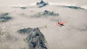 Red airplane flying over snow mountains with pine trees in the clouds. Stock Photos