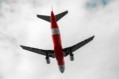 Red airplane low angle view Royalty Free Stock Photo