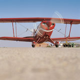 Red airplane ready to take off Stock Images