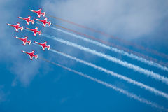 Red airplanes at airshow. Red jet airplanes fly in formation at airshow Stock Photography