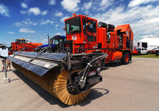 Red airport sweeper. Sweeping machine parked on the airport apron Royalty Free Stock Image