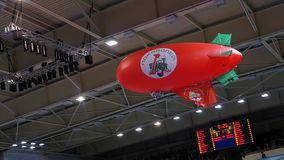 10.14.2017 Novosibirsk, the Volleyball teams match. Red airship flies through the stadium during a break at a match. Red airship flies through the stadium during stock footage