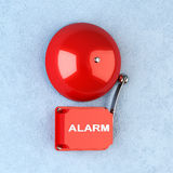 Red alarm. 3d render of red retro alarm on blue wall Stock Illustration