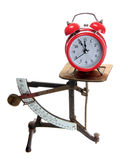 Red alarm bell on old letter scales Stock Photo