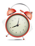 Red alarm clock. Classic red alarm clock over white background Royalty Free Stock Photography