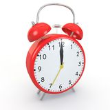 Red alarm clock on an  background. Red alarm clock on  background show time 12:00 Stock Photos