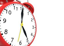 Red alarm clock on an  background Royalty Free Stock Photography