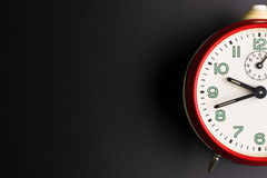 Red alarm clock  on black background, Time concept, Rush Stock Photo