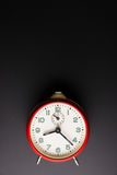 Red alarm clock  on black background, Time concept, Rush Stock Photography