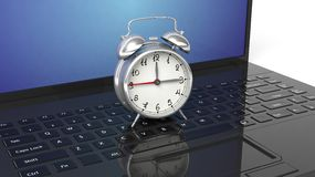 Red alarm clock on black laptop Royalty Free Stock Photography