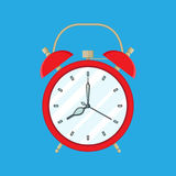 Red Alarm Clock on blue background Stock Photos