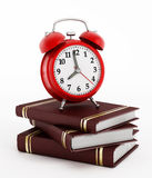 Red alarm clock on books Stock Images