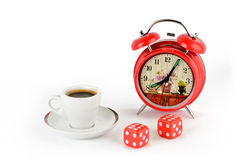 Red alarm clock, coffee cup and dice Stock Photos