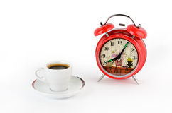 Red alarm clock and coffee cup Royalty Free Stock Image