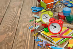 Red alarm clock and colorful school supplies Stock Photography