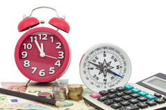Red alarm clock with compass ,coins and Calculator on money bank Stock Photography
