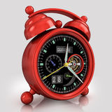 Red  alarm clock 3. Red exclusive mechanical alarm clock with a tourbillon on a gray background with reflection Royalty Free Stock Photography