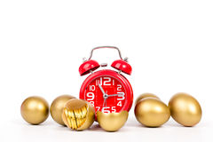 Red alarm clock,gold egg  and gold coin Stock Photos