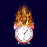 Red Alarm Clock Icon on Fire Flame. On Dark Background Royalty Free Stock Photos