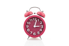 Red alarm clock isolated on white background. Stock Photo