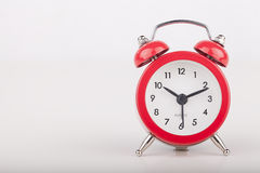 Red alarm clock Stock Images