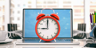 Red alarm clock on a laptop - office background. 3d illustration. Time for work. Red alarm clock on a laptop - office background. 3d illustration Stock Image