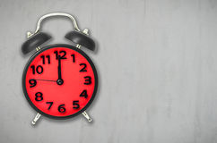 Red Alarm clock lunch time on gray cement background Stock Photography