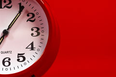 Red Alarm clock on red background Stock Images