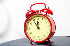 Red alarm clock in a retro style Stock Photos