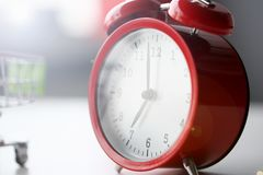Red alarm clock set at seven in the morning stock images