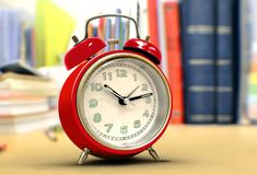 Red alarm clock on study desk Stock Images