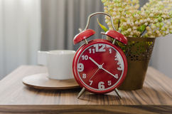 Red alarm clock on table Stock Images