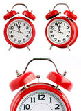Red alarm clock on white background. Red retro alarm clock on a white background. midnight, noon Stock Photography