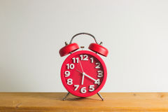 Red alarm clock on wooden.  Stock Photo