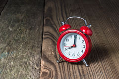 Red alarm clock on the wooden table Stock Photography