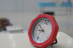 Red alarmclock in office Royalty Free Stock Photo